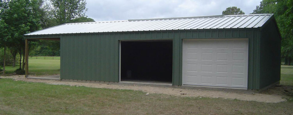 Green two door garage with car port